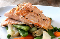 Grilled salmon with vegetables dish Royalty Free Stock Photos