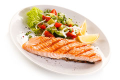 Grilled salmon and vegetables. Fish dish - roasted salmon and vegetables stock photo