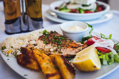 Grilled salmon and vegetables Stock Images