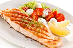 Grilled salmon with vegetables stock image