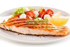 Grilled salmon with vegetables royalty free stock image