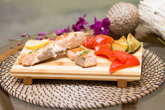 Grilled salmon with vegetables. Pepper, lemon, eggplant Royalty Free Stock Photo