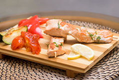 Grilled salmon with vegetables. Pepper, lemon, eggplant Royalty Free Stock Images