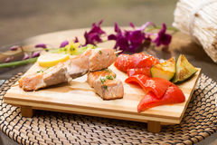 Grilled salmon with vegetables. Pepper, lemon, eggplant Royalty Free Stock Photography