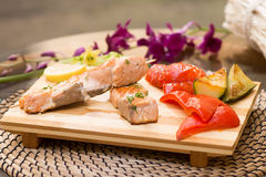 Grilled salmon with vegetables. Pepper, lemon, eggplant Stock Image
