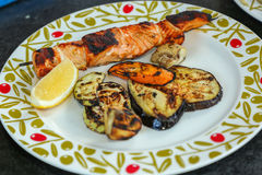 Grilled salmon. And vegetables in a plate stock image