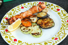 Grilled salmon. And vegetables in a plate royalty free stock photo