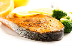 Grilled salmon and vegetables on plate close up Stock Image