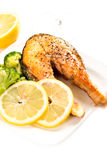 Grilled salmon and vegetables on plate close up Royalty Free Stock Image