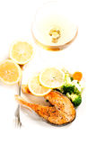 Grilled salmon and vegetables on plate vertical Royalty Free Stock Photos