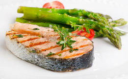 Grilled salmon with vegetables. Selective focus Royalty Free Stock Photos