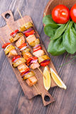 Grilled salmon and vegetables on skewers. Royalty Free Stock Images
