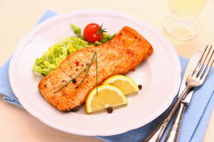 Grilled salmon, vegetables and wine Stock Image