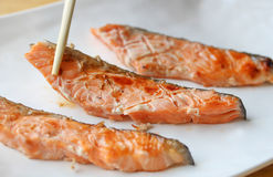 Grilled salmon. Grilled salmon in white plate royalty free stock photography