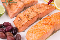 Grilled salmon on white plate Royalty Free Stock Images