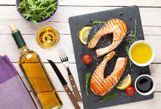 Grilled salmon and white wine on wooden table Stock Photo
