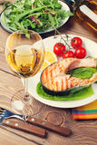 Grilled salmon and whtie wine Royalty Free Stock Image