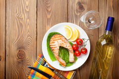 Grilled salmon and whtie wine Stock Image