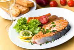 Grilled Salmon With Lettuce And Tomato- Close Up Royalty Free Stock Photography