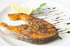 Grilled salomon steak with lemon royalty free stock photography