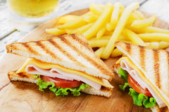 Grilled sandwich with ham cheese Royalty Free Stock Images