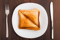 Grilled sandwich on plate Royalty Free Stock Photo