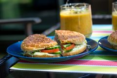 Grilled sandwich snack with soup on a terrace royalty free stock photography