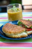 Grilled sandwich snack with soup on a terrace stock photo