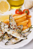 Grilled sardine fish and french fries Royalty Free Stock Photography