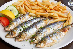 Grilled sardine fish and french fries Stock Photography