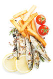 Grilled sardine fish with french fries Stock Images