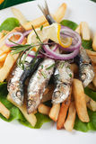 Grilled sardine fish with lemon and herbs Stock Photo