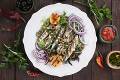 Grilled sardine fish with lemon and onion Royalty Free Stock Photo