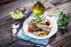 Grilled sardine. On wooden background Stock Image