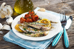 Grilled sardine. On wooden background Stock Images
