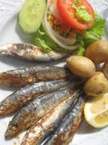 Grilled sardines. With potatoes and vegetables stock photo