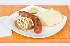 Grilled Sausage with arepa and cooked potato Royalty Free Stock Images