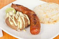 Grilled Sausage with arepa and cooked potato Royalty Free Stock Photos