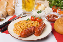 Grilled sausage with beans Royalty Free Stock Image