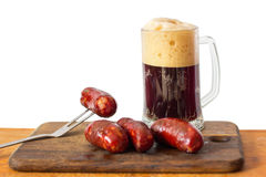 Grilled sausage and beer. stock photo