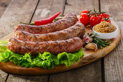 Grilled sausage on a board Royalty Free Stock Image