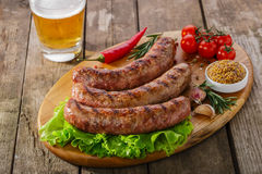 Grilled sausage on a board Stock Photos