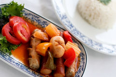 Grilled sausage. With brown sauce served with rice Royalty Free Stock Image