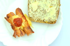 grilled sausage in cheese on a plate  Royalty Free Stock Image
