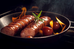 Grilled sausage with cherry tomatoes Royalty Free Stock Images