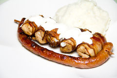 Grilled sausage and chicken with mash Stock Images