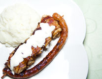 Grilled sausage and chicken with mash Royalty Free Stock Photos