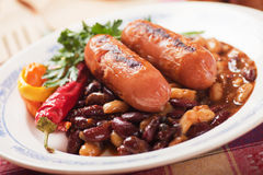 Grilled sausage with chili beans Royalty Free Stock Image