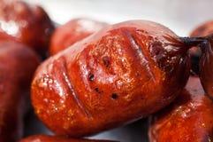 Grilled sausage closeup Stock Images