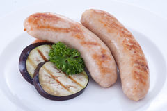 Grilled sausage on dish with ingredients Royalty Free Stock Photo